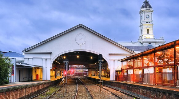 Places to visit in Ballarat Historic train station on victorial railways with clock tower and multiple tracks to platforms