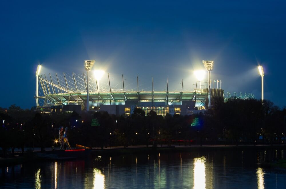 Melbourne Private Tours MCG loodlit for a twilight match of Australian Rules Football